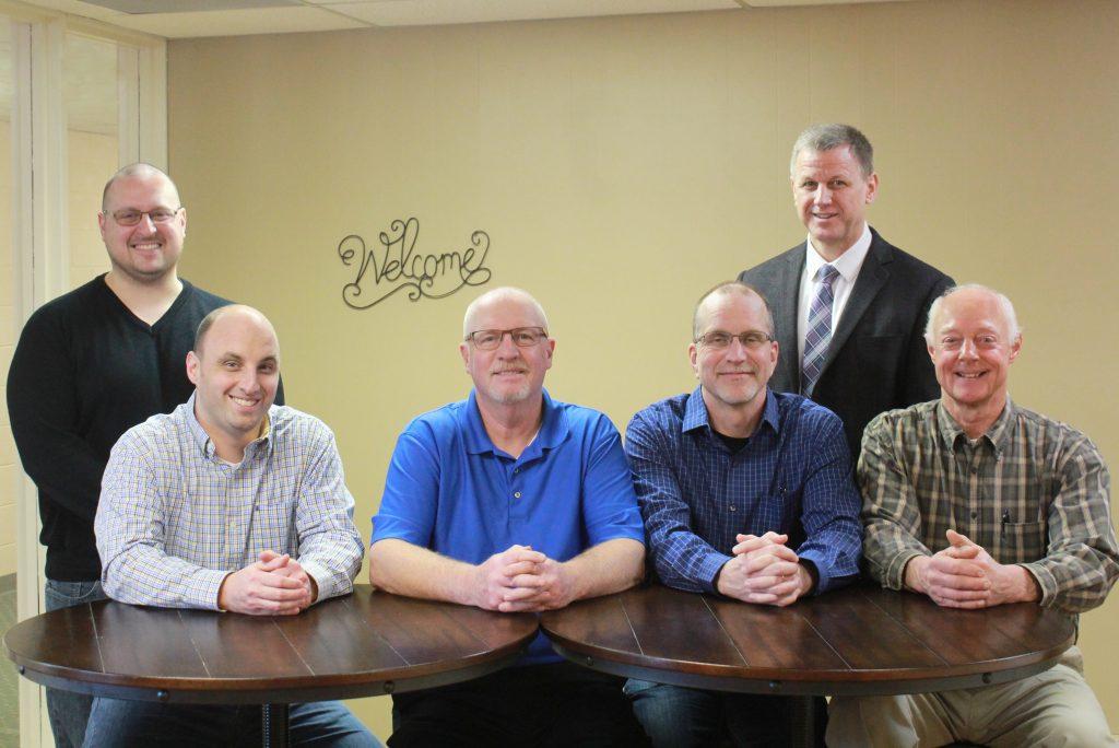 Left to Right: Joe Hart, Matthew Price, Graig Hayes, Jim Rizzardi, John Helmuth (standing), Jan Peck, Doug Troxell (not pictured)